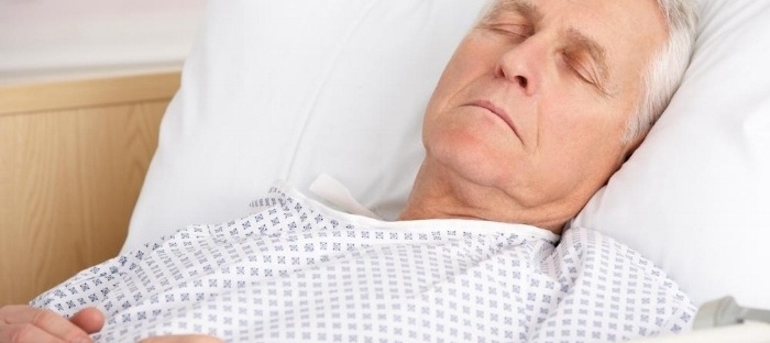 older-man-sleeping-in-hospital-gown-in-bed-553541-edited-030460-edited.jpg